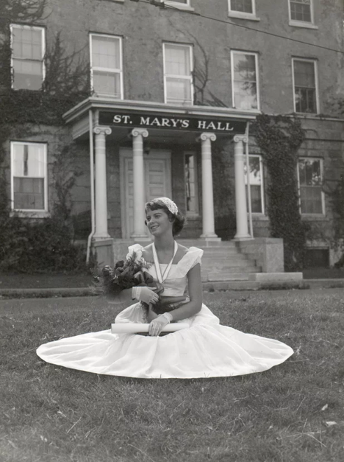 student outside of St. Mary's Hall